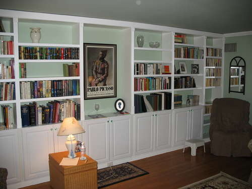 Get built in bookcases inexpensively by using pre made for Ready built cupboards